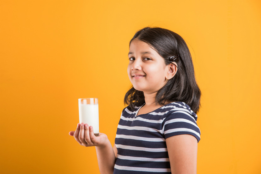 young girl with glass of milk