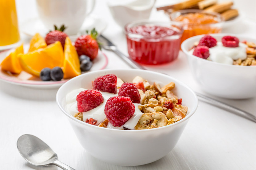 Bowl of cereal with fruit on top