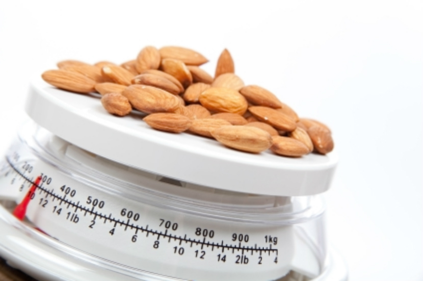 measuring almonds on a scale