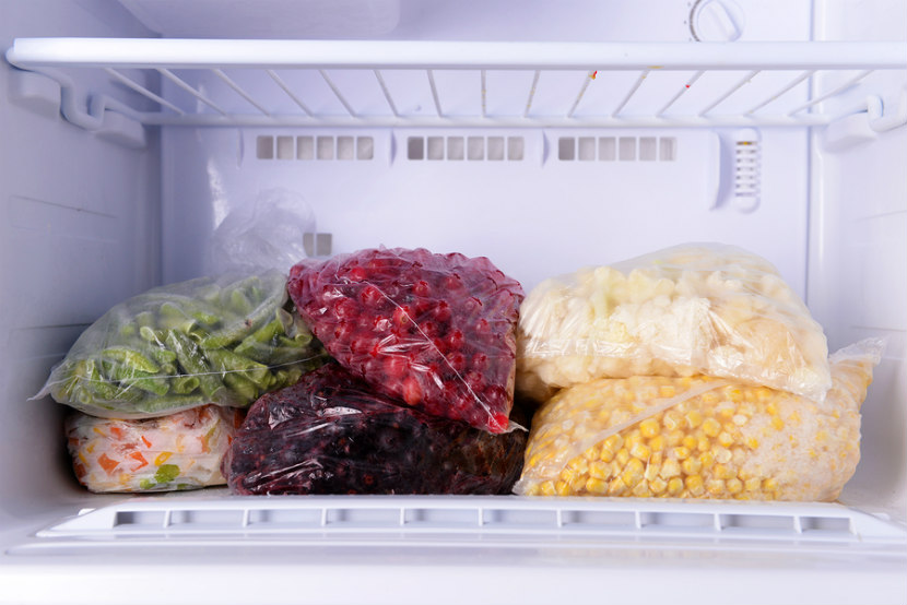 bags of frozen foods in freezer