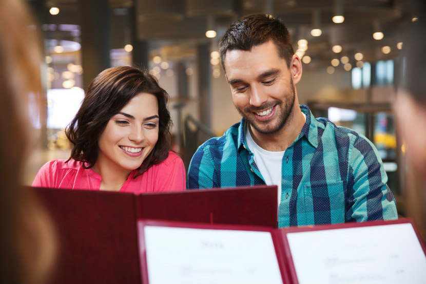couple looking at a menu at a restaurant