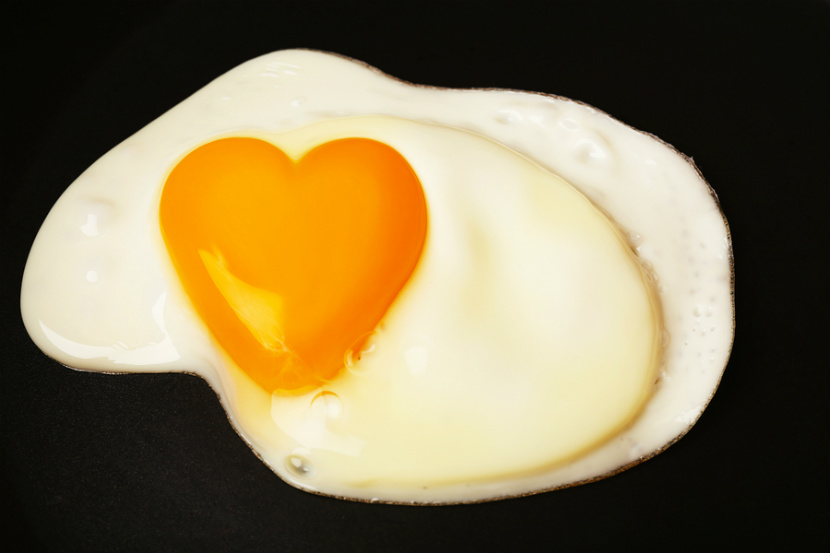 egg with a yolk in the shape of a heart