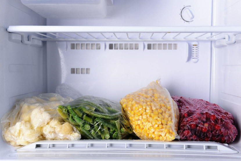 vegetables in bags in freezer