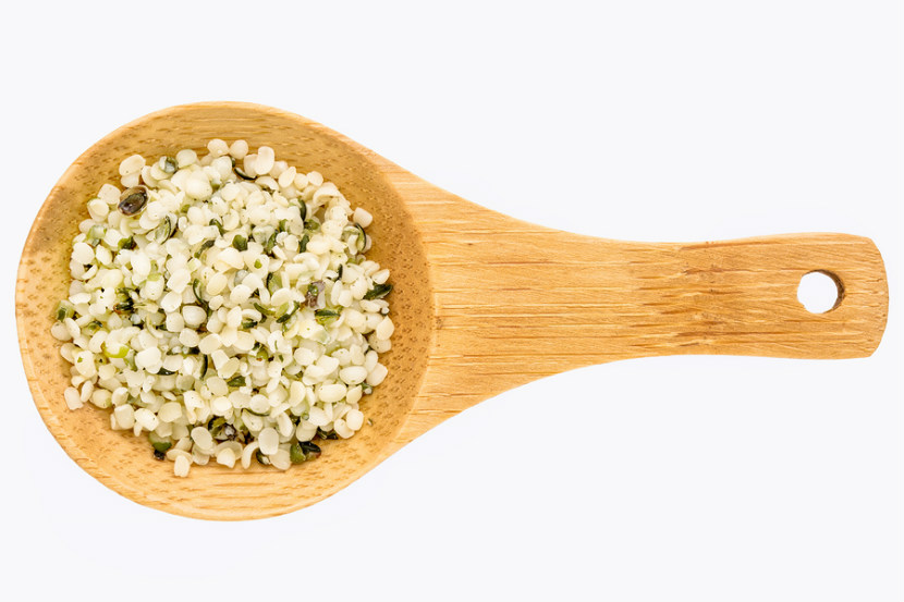 Hemp seeds, spoon with hemp seeds