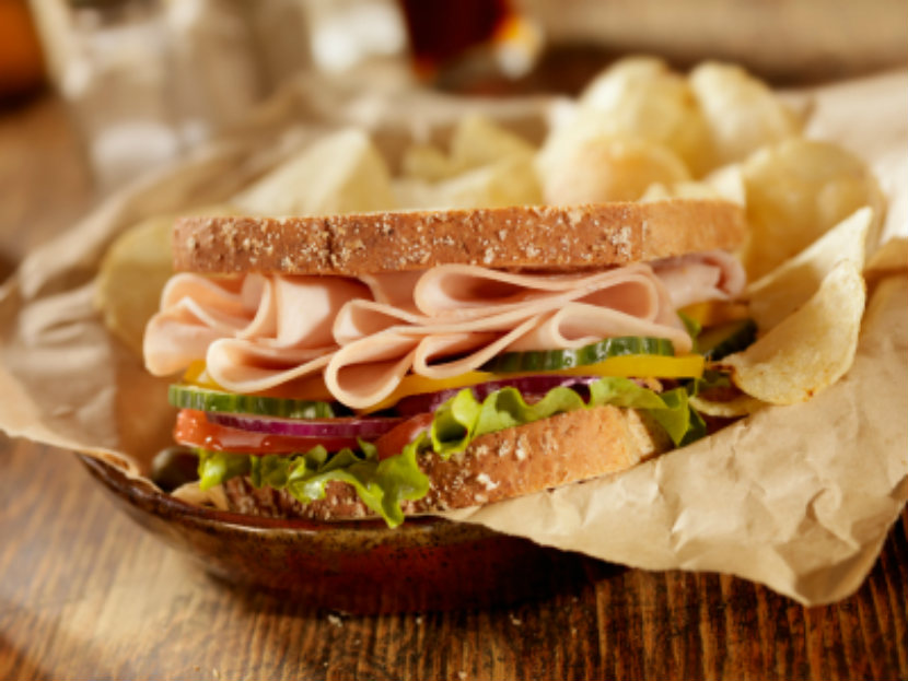 sandwich made with cold cuts and vegetables