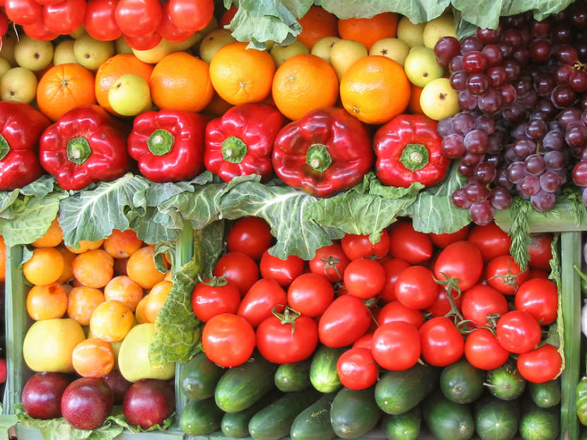 colourful fruit and vegetables like red peppers, organges and grapes
