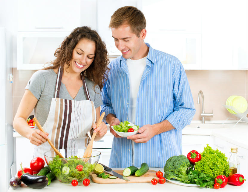 a couple in the kitchen making a healthy meal