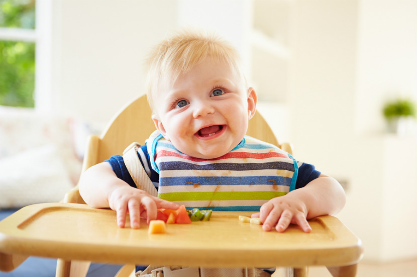 baby eating at his high chair
