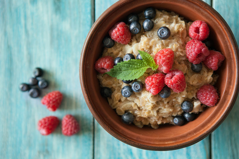 bowl of oatmeal with with berries in it