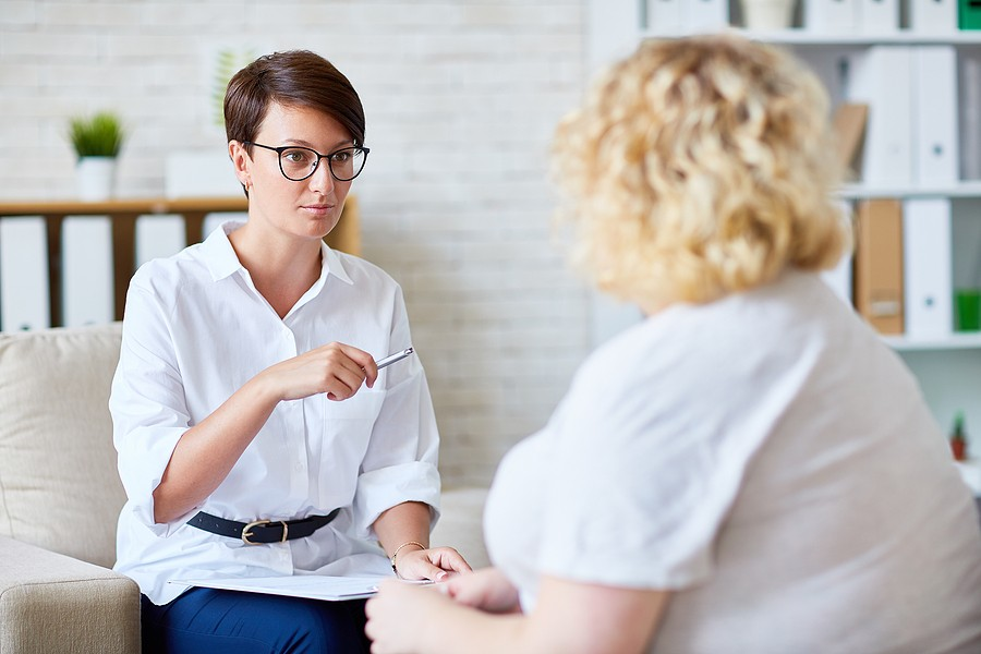 woman at a counselling session with a female dietitian